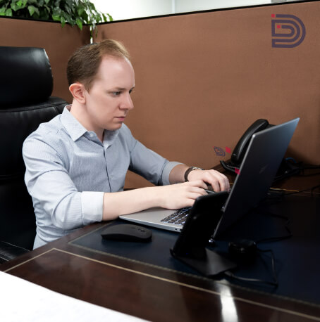 Team member at the computer